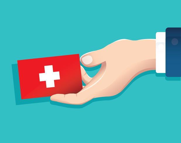 Hand, die die Schweiz-Flaggenkarte mit blauem Hintergrund hält