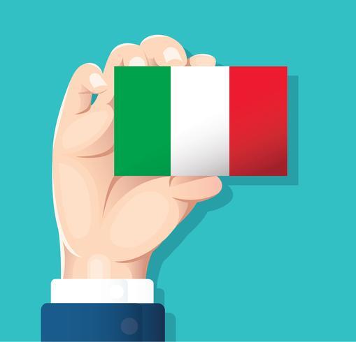 Mano que sostiene la tarjeta de la bandera de Italia con fondo azul. vector