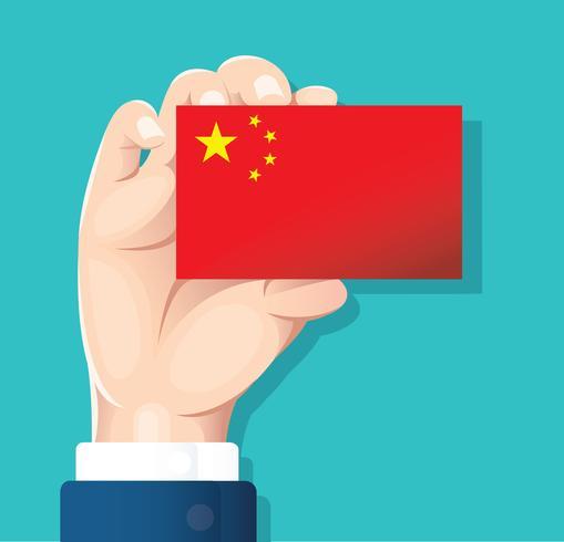 mano que sostiene la tarjeta de la bandera de china con fondo azul vector