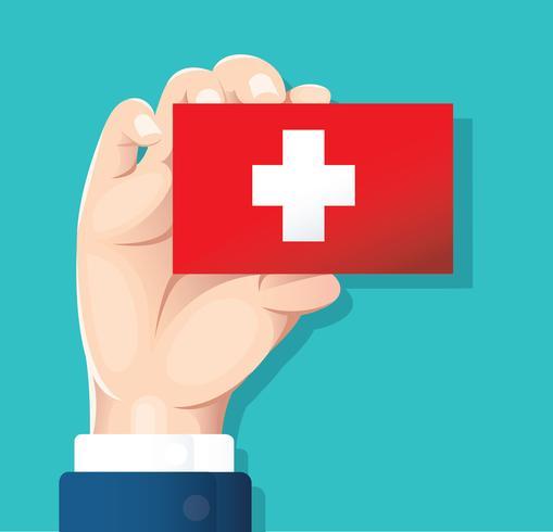 mão segurando o cartão de bandeira Suíça com fundo azul vetor