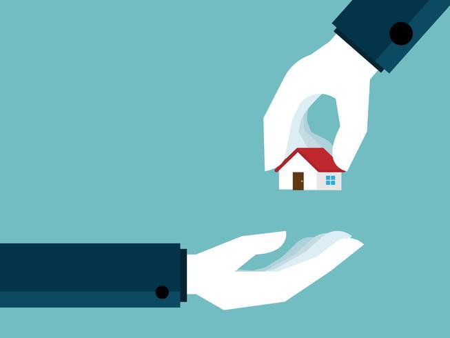 concetto di immobile mano dando casa a portata di mano