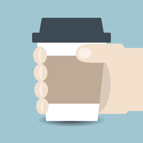 Mano sosteniendo una taza de café vector