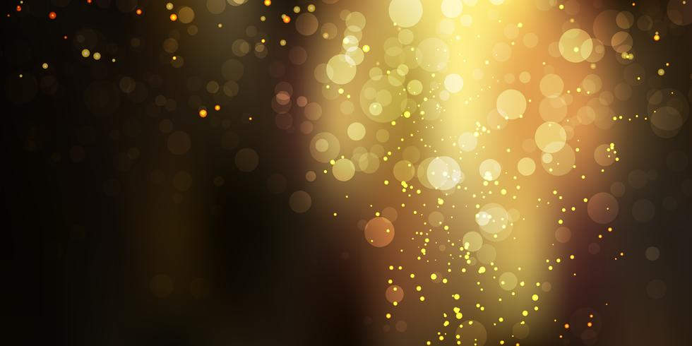 Gouden schitterende fonkeling stardust op zwarte achtergrond met bokehlichten
