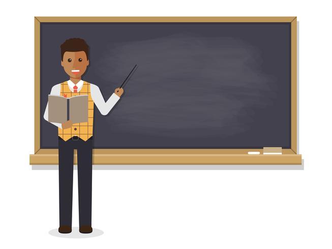 African teacher teaching in classroom.