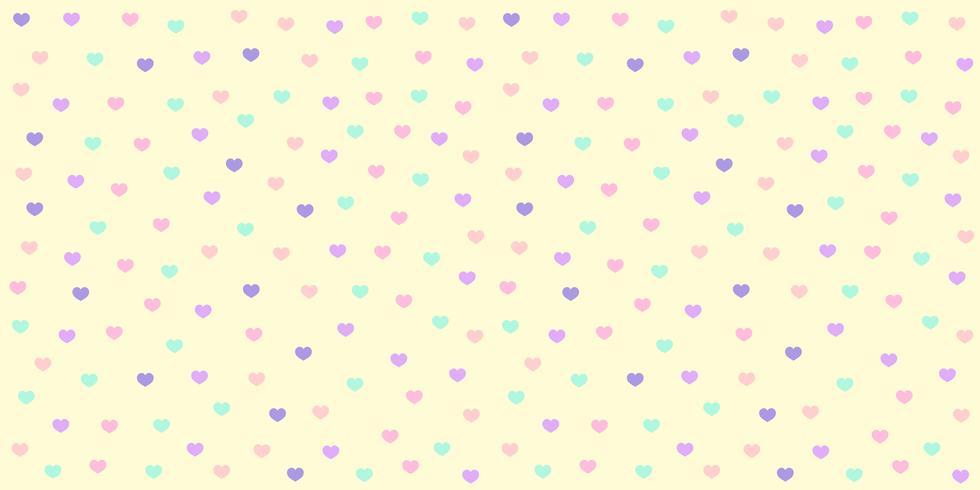 Patrón de corazón sin costuras en color pastel. Brillo colorido del corazón en el fondo amarillo para la impresión de la tela del bebé, el papel pintado, la materia textil, el papel de embalaje, la bandera y el diseño de la tarjeta.