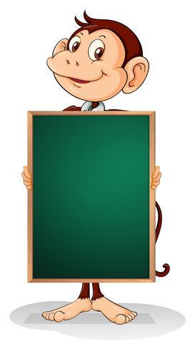 A male monkey holding an empty blackboard