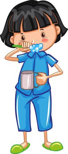 Una ragazza che lava i denti