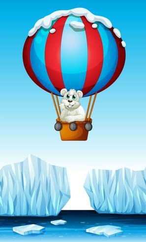 Eisbär, der in den Ballon reitet