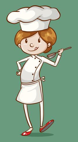 Weiblicher Chef, der Lebensmittel im Löffel schmeckt