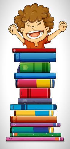 Niño y pila de libros