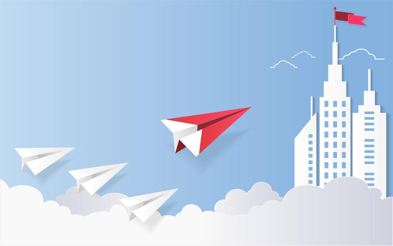 Leadership concept, Red plane and white architectural building landscape with a flag on the top, Blue sky background.