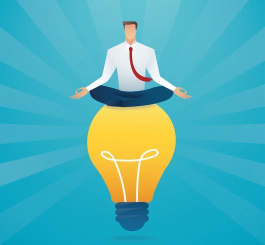 businessman sitting on light bulb creative concept