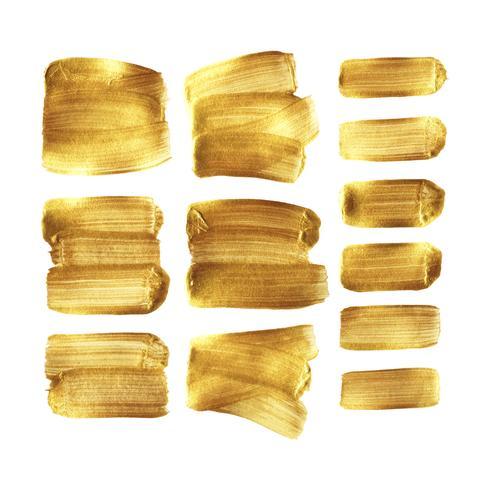 Gouden verf beroerte uitstrijkje set geïsoleerd op een witte achtergrond