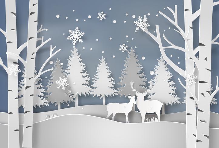 Cervi nella foresta con la neve.