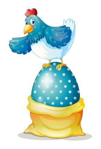Una gallina encima de un gran huevo de Pascua