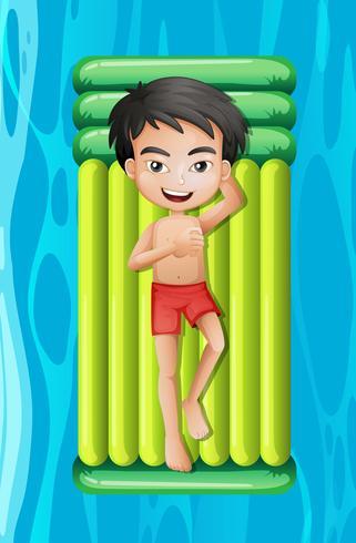 Jeune garçon, délassant, sur, flotteur piscine