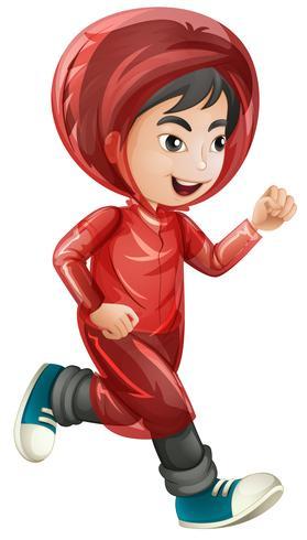 Chico en impermeable rojo corriendo