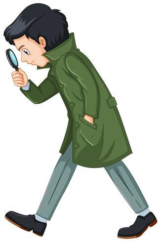 Detective in soprabito verde che tiene la lente d'ingrandimento