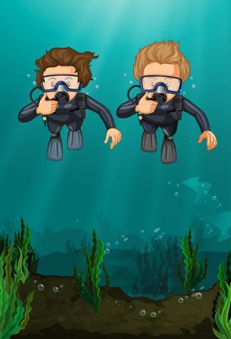 Two men scuba diving under the ocean