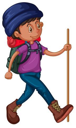 Hombre con mochila y bastón. vector