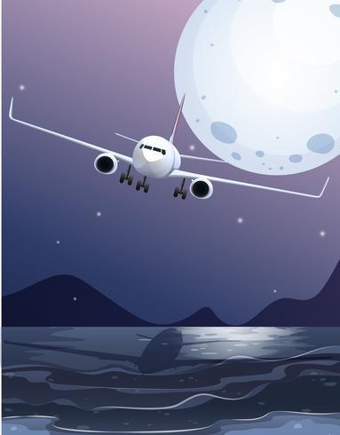 Un aeroplano che sorvola il mare sulla luna piena