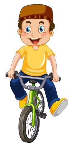 Een moslimjongen fietsten