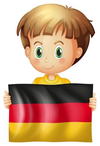 Glücklicher Junge mit Flagge von Deutschland