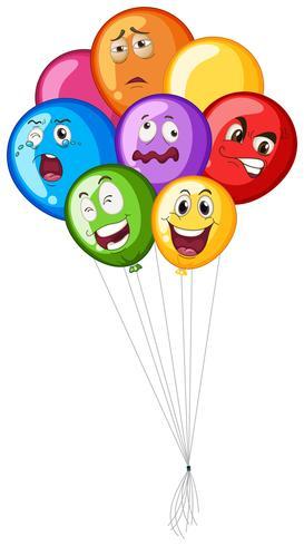 Beaucoup de ballons avec des émotions faciales