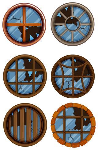 Round windows with broken glass vector
