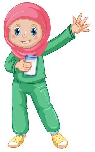 Ein muslimisches Mädchen trinkt Milch