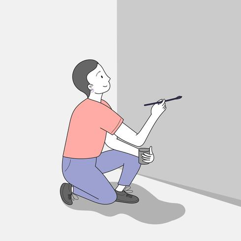Young man painting a wall.