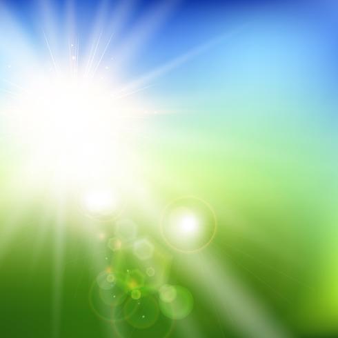 O verão borrou o campo verde e o fundo da paisagem do céu azul com luz solar.