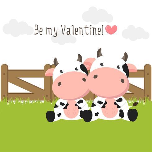 Le coppie delle mucche sveglie nell'amore sul campo di erba verde.