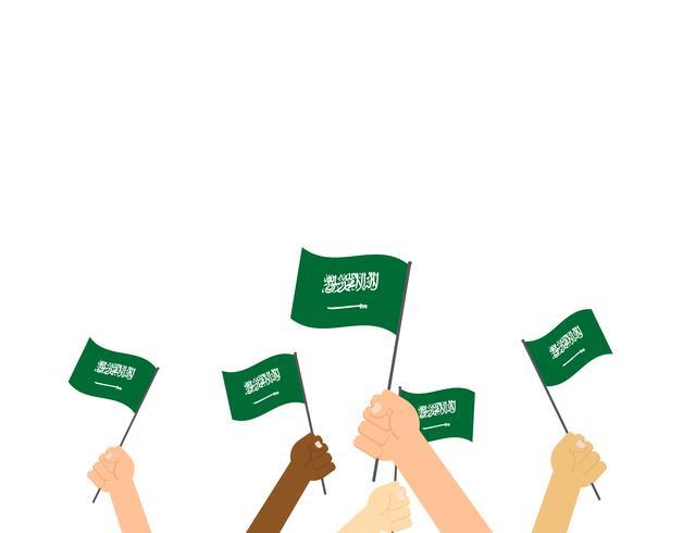 Mains d'illustration vectorielle tenant des drapeaux de l'Arabie saoudite isolés sur fond