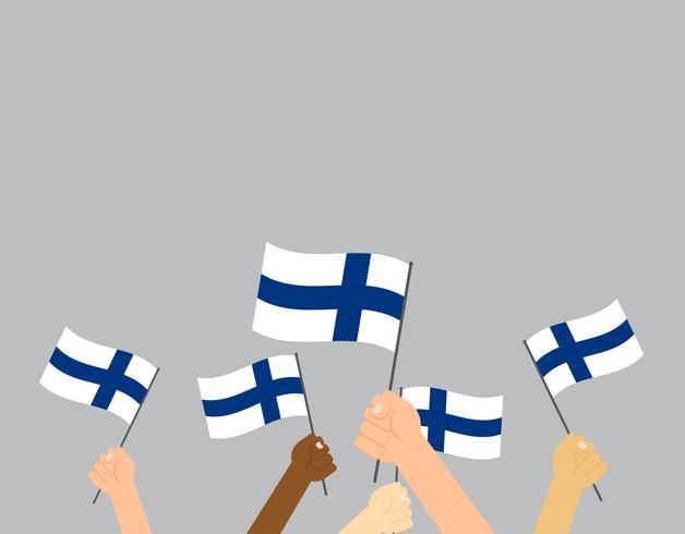 Manos de ilustración vectorial sosteniendo banderas de Finlandia sobre fondo gris