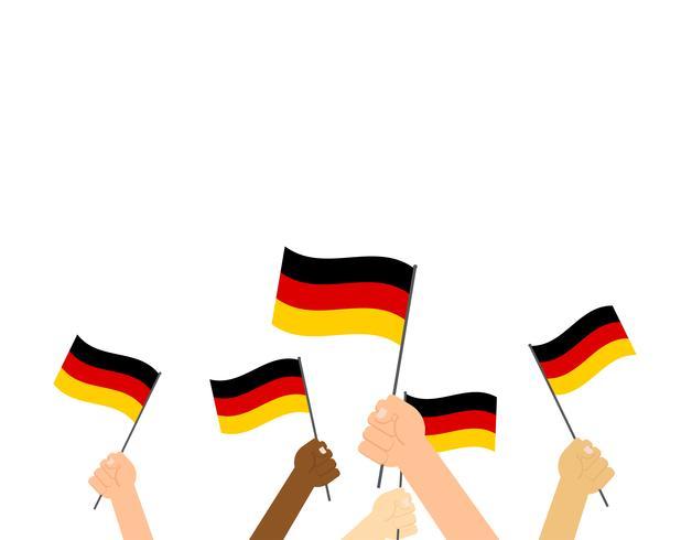 Vectorillustratieg handen die de vlaggen van Duitsland op witte achtergrond houden