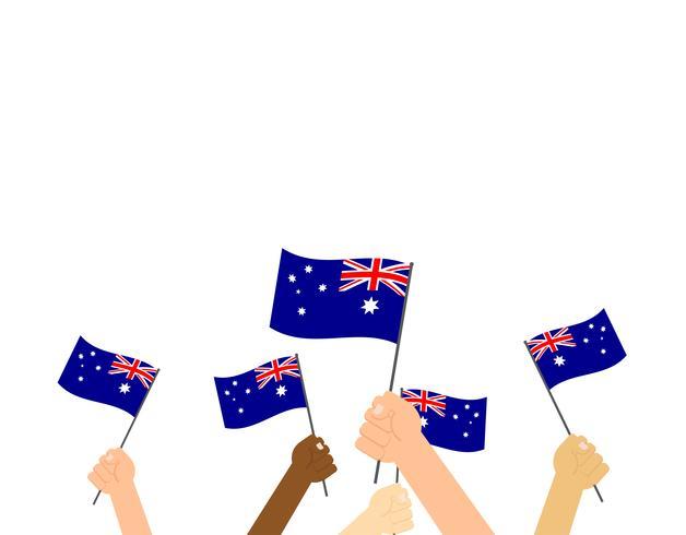 Mains d'illustration vectorielle tenant des drapeaux de l'Australie sur fond blanc