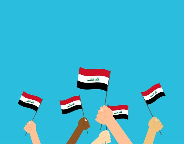 Manos de ilustración vectorial sosteniendo banderas de Irak aisladas sobre fondo azul