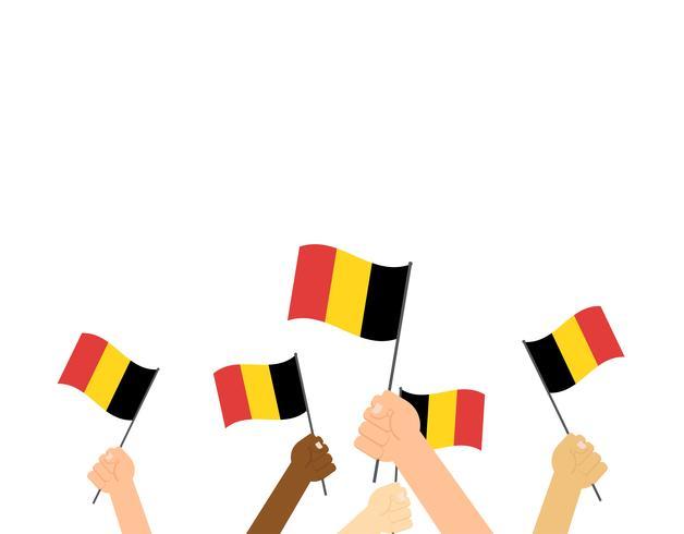 Manos de ilustración vectorial sosteniendo banderas de Bélgica sobre fondo blanco
