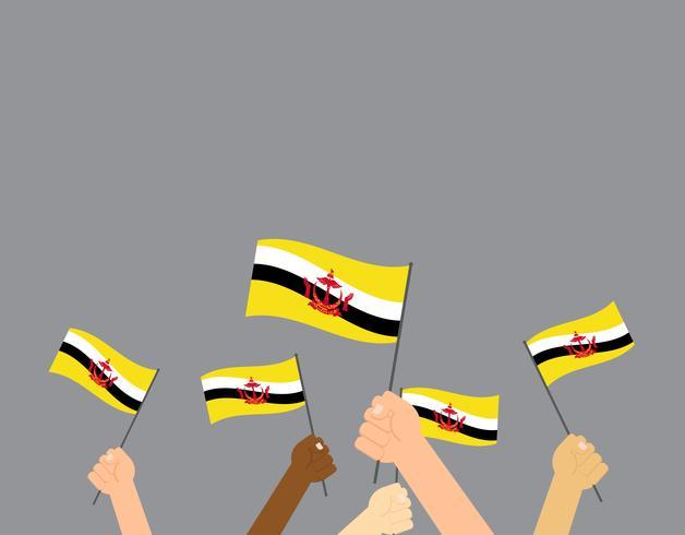 Manos de ilustración vectorial sosteniendo banderas de Brunei aisladas sobre fondo