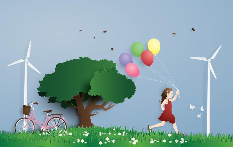 La niña corriendo en el campo con globo. Estilo del arte en papel. vector