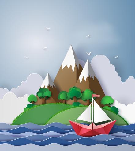 barco de vela de papel flotando en el mar
