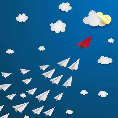 Aereo di carta rosso che porta quelli bianchi, concetto di leadership.