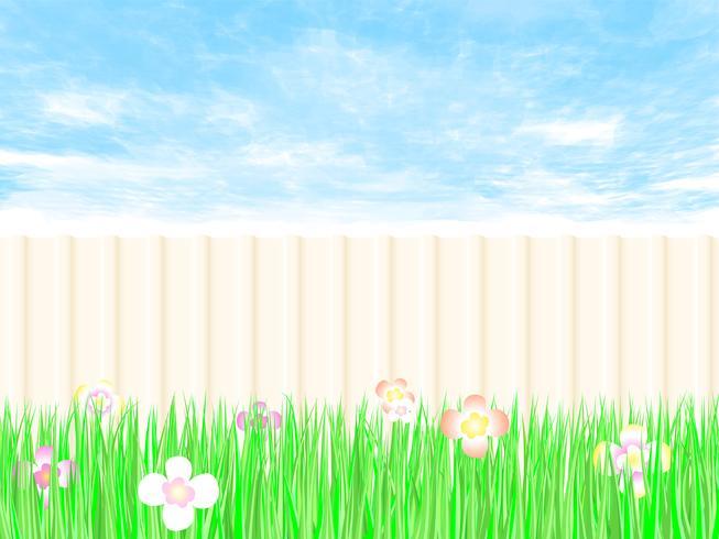 Trädgårdsarbete staket en bakgård med blå himmel.