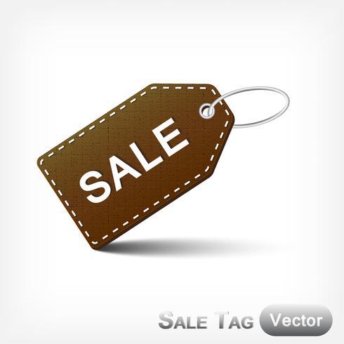 Etichetta di vendita in pelle con anello metallico su sfondo bianco