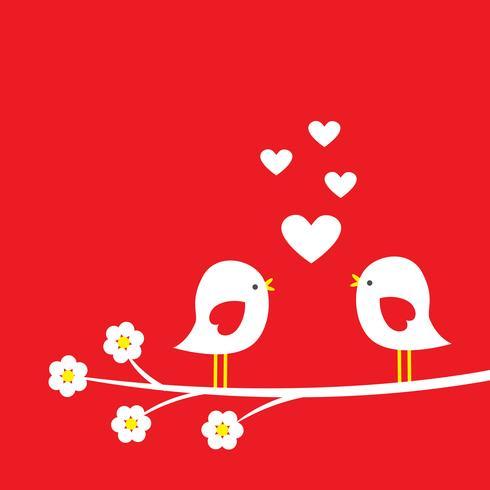 Dois pássaros bonitos no ramo de florescência - cartão para dia dos namorados