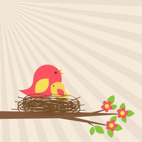 Famiglia di uccelli nel nido sul ramo fiorito