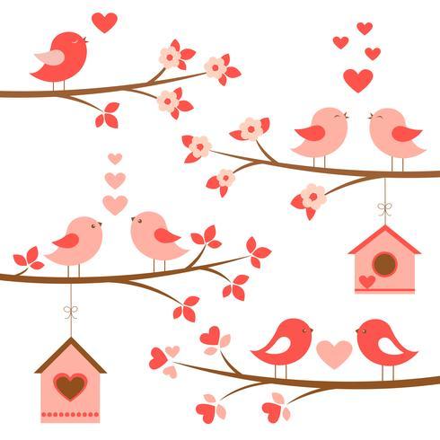 Satz nette Vögel in der Liebe auf blühenden Niederlassungen