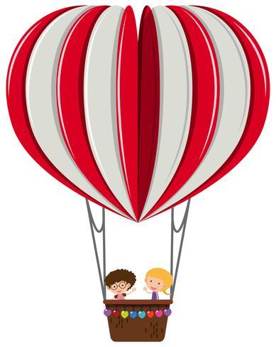 Niño y niña en globo de corazón vector