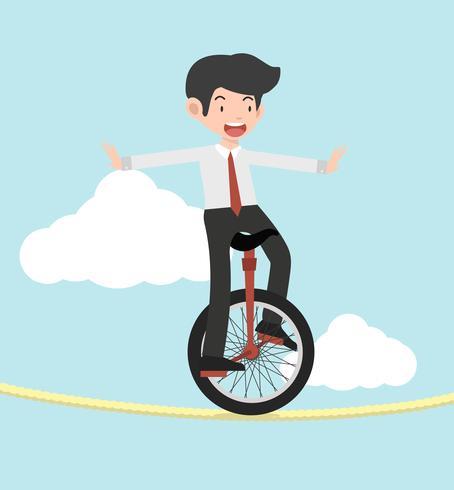 uomo d'affari che guida il monociclo su una corda